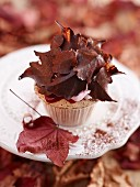 An autumnal cupcake with cranberry cream and cranberry purée