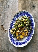 Oven roasted vegetables (brussels sprouts, parsnips, yellow beets), on a serving platter