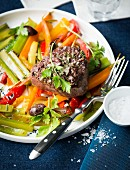 Fillet steak on a bed of vegetables