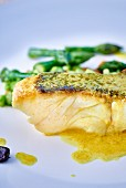Seabass fillet with butter sauce and black garlic