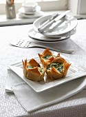 Strudel pastry baskets with spinach
