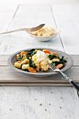 Steamed polenta with spring vegetables