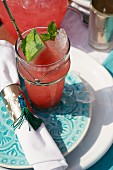Oriental watermelon drink with ice cubes and mint