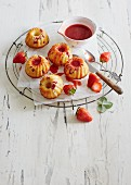 Mini lemon Bundt cakes with strawberry sauce