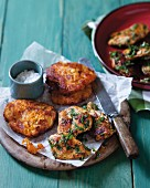 Spicy chicken medallions with sweet potato fritters