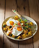 Bombay potatoes with fried egg