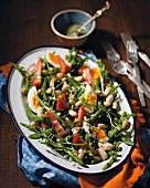 White bean salad with olives and rocket