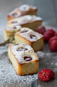 Financiers with raspberries and icing sugar