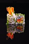 Two California maki with carrots