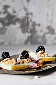 Blackberries with walnuts and acacia honey on manchego cheese