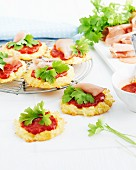 Mini cauliflower pizzas with tomato sauce and parsley