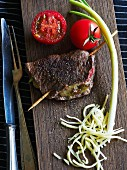 Stuffed beef steak with tomatoes and spring onions