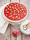 Cheesecake with strawberry glaze and hazelnuts