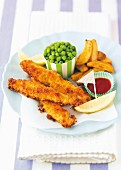 Fish fingers with potato wedges and peas