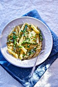 Penne with asparagus, cheese and herbs