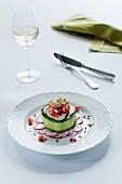 Vegetable cake on a radish salad