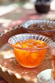 White cherry jam in a glass bowl