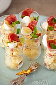 Potato salad with salami and quail's eggs