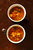 Vegetable soup with pumpkin served in cappuccino cups