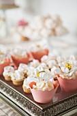 Wedding cupcakes on a silver tray for a wedding buffet