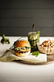 A vegetarian bean burger with cucumber relish and a chickpea salad