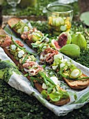 Baguettes topped with Parma ham and marinated beans