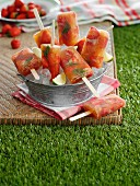 Homemade strawberry ice lollies for a picnic