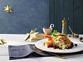 Salmon in puff pastry on mashed potatoes with prawns, peas and beetroot (Sweden)