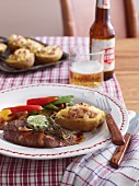 Rump steak with herb butter, fried vegetables and baked potatoes (USA)
