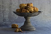 Spelt scones with raisins and cranberries on a grey, antique stand