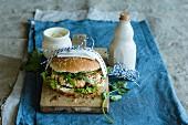 Salmon burger with wasabi sauce
