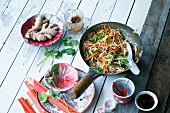 Stir-fried noodles with colourful vegetables and tuna fish