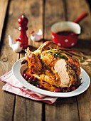 Roast chicken with a sausage meat and cranberry filling