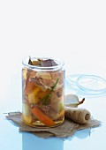 Rustic vegetable soup in preserving jar