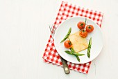 Raclette with asparagus and tomatoes