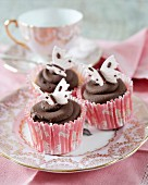 Dark chocolate cupcakes with fondant butterflies
