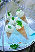 Ice cream cones in glasses on a garden table