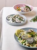 Various types of herring canapés (Christmas)