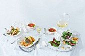 A festive Christmas meal featuring tomato soup, salmon, millet tartlets, salad and white wine