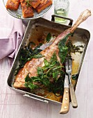 Leg of lamb with thyme and bay leaves braised in a bed of herbs
