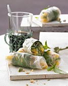 Summer rolls filled with mango, cucumber and wasabi nuts