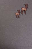 Two deer-shaped biscuits on grey surface