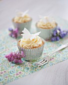 White chocolate cupcakes decorated with buttercream
