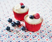 Banana cupcakes decorated with raspberries and blueberries