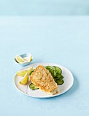 Breaded hake fillet with a cucumber salad