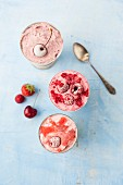 Strawberry ice, cherry ice cream and raspberry ice cream in metal cups (seen from above)
