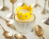 A cupcake decorated with a crown