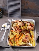 Lemon chicken on a baking tray