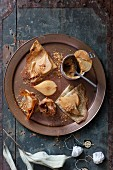 Crepes with poached pears, caramel and macadamia nut crumbs