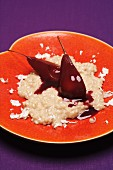 Cinnamon risotto with pears poached in red wine